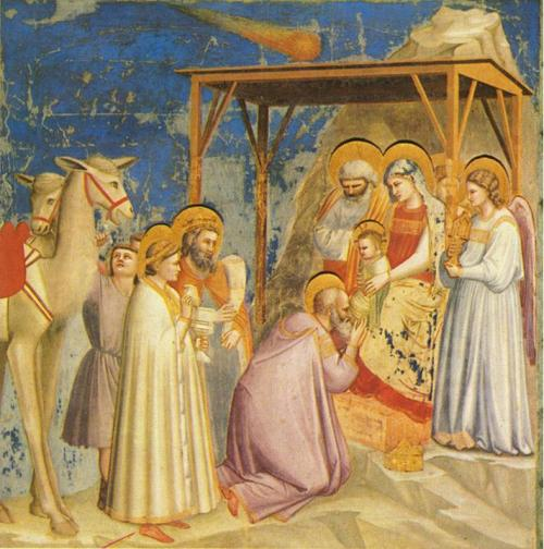 La adoración de los Reyes Magos de Giotto. Obsérvese, además de la estrella en forma de comenta, que Baltasar aún es blanco.